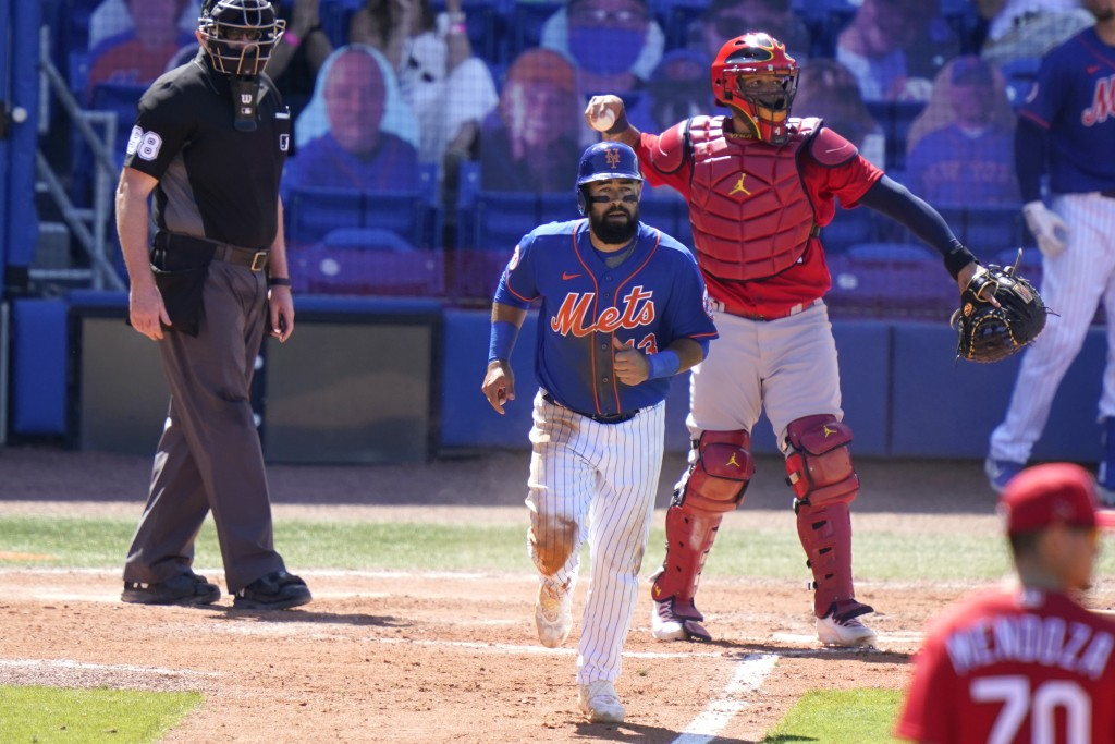 New York Mets' Luis Guillorme, center, draws a walk off St. Louis Cardinals relief pitcher Jordan Hicks during the fifth inning of a spring training b...