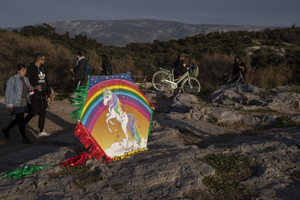 A kite on the ground as people walk at Filopapou hill on Sunday, March 14, 2021. The coronavirus pandemic, which hit Cyprus, and Greece especially har...