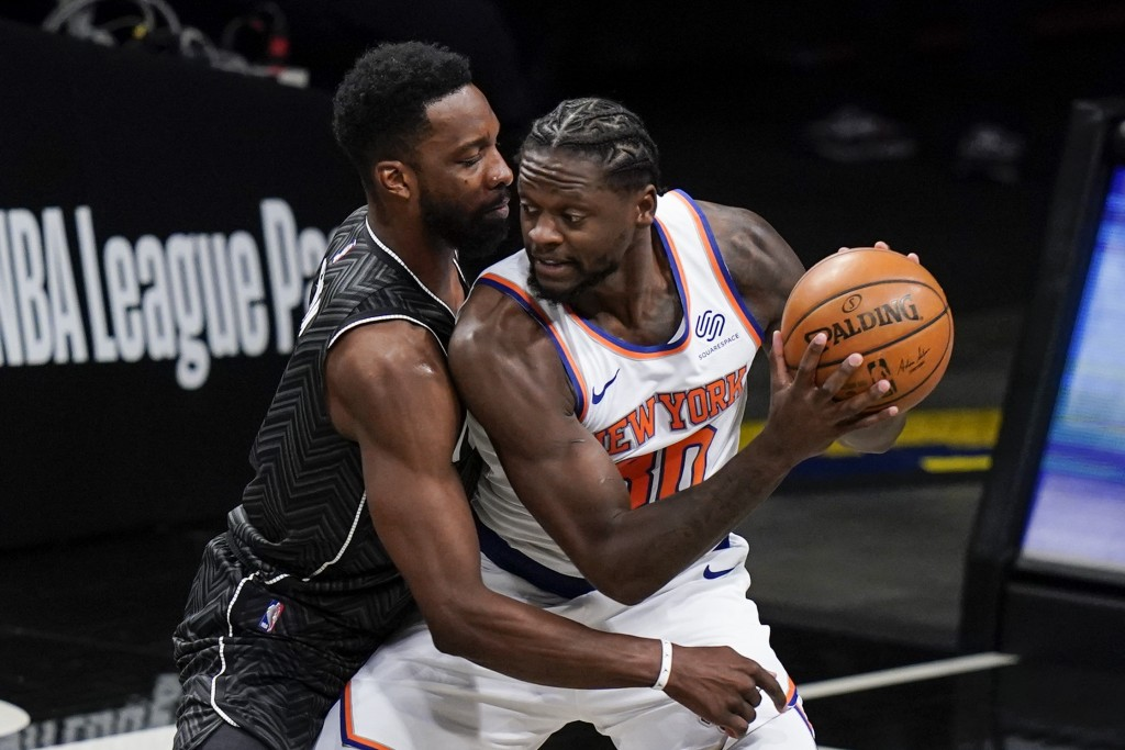 Brooklyn Nets' Jeff Green, left, defends New York Knicks' Julius Randle (30) during the first half of an NBA basketball game Monday, March 15, 2021, i...
