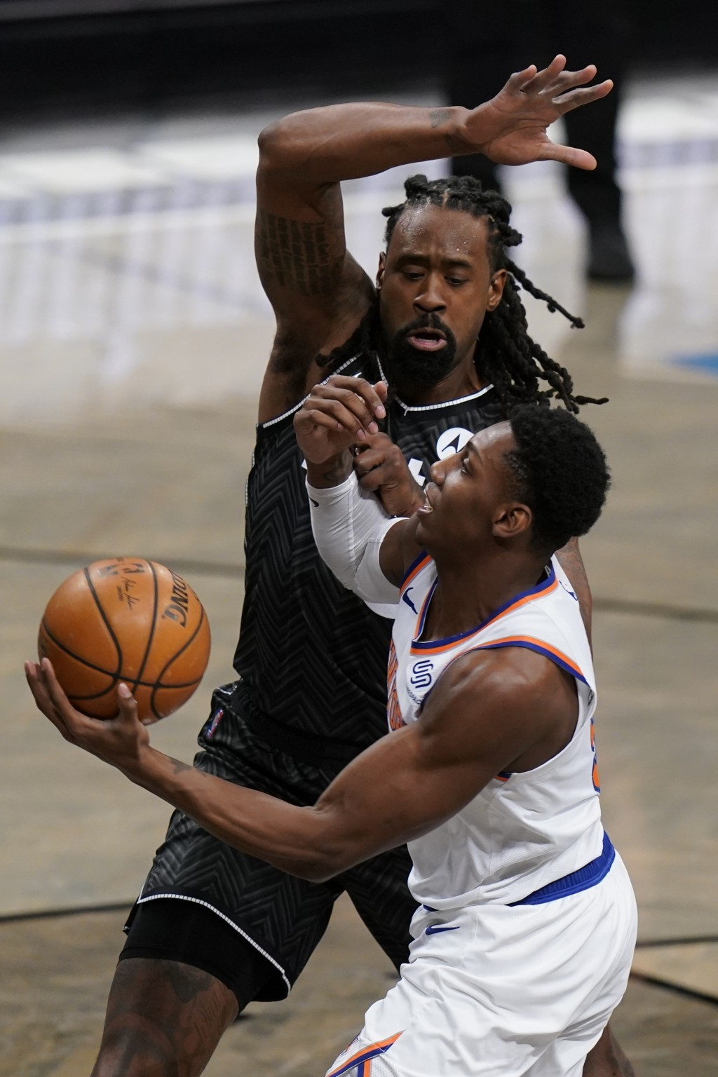 New York Knicks' RJ Barrett, right, drives past Brooklyn Nets' DeAndre Jordan during the second half of an NBA basketball game Monday, March 15, 2021,...