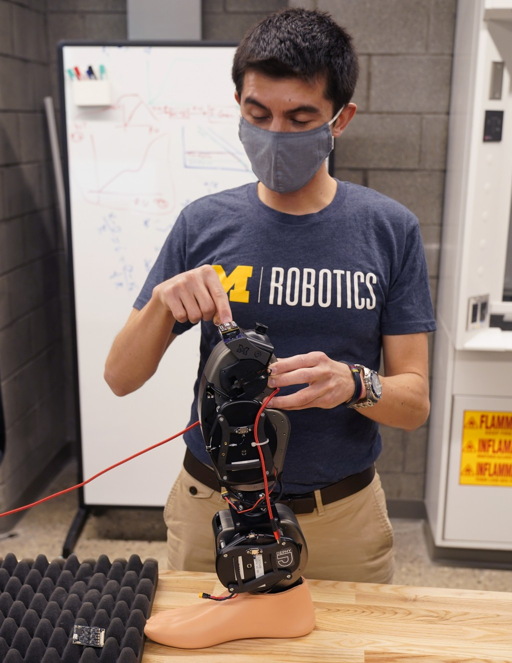 Edgar Bolivar describes the purpose of wearable robots at the University of Michigan's Ford Motor Co. Robotics Building is seen, March 12, 2021 in Ann...