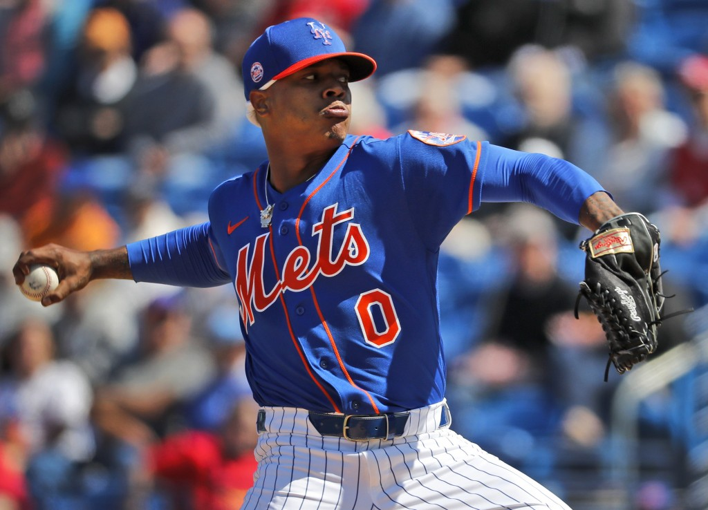 FILE - In this Feb. 28, 2020, file photo, New York Mets pitcher Marcus Stroman throws during the first inning of a spring training baseball game again...