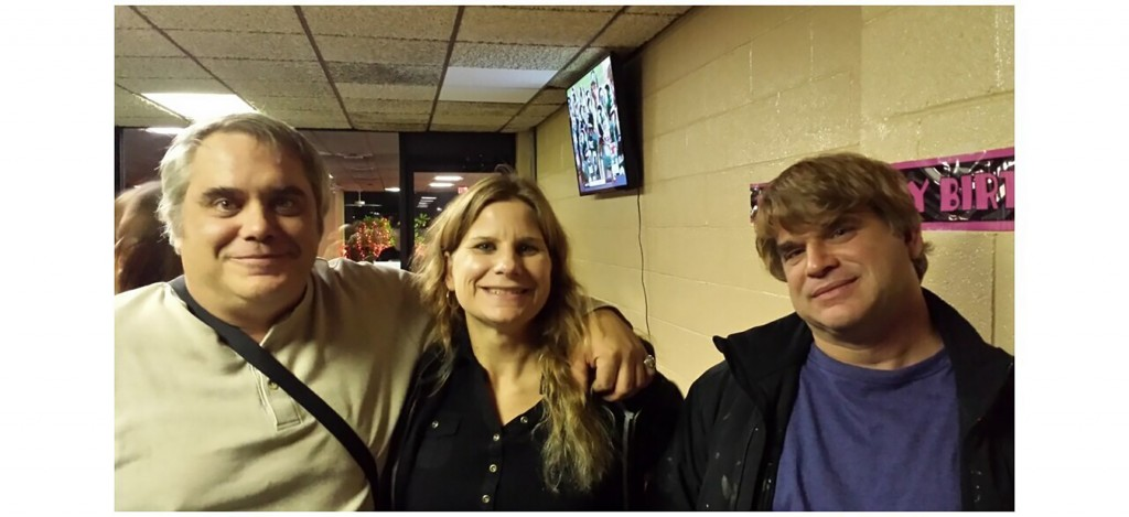 This October 2015 photo provided by John Michels, left, shows his brother Paul Andre Michels, right, posing with his sister Sarah Michels and himself,...