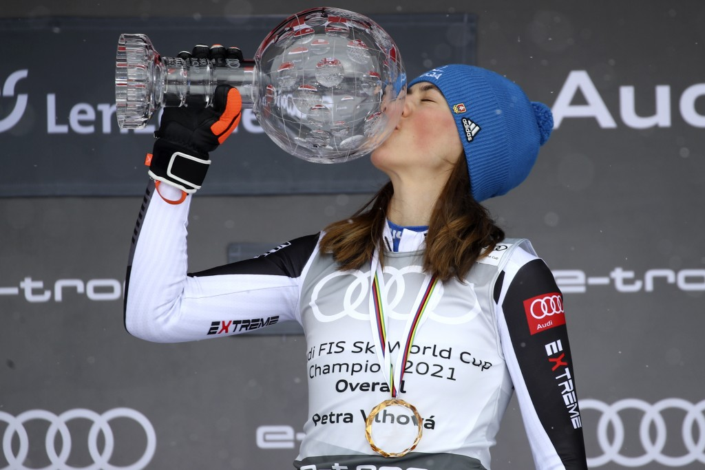Slovakia's Petra Vlhova kisses the trophy of the alpine ski, women's World Cup overall title, in Lenzerheide, Switzerland, Sunday, March 21, 2021. (AP...