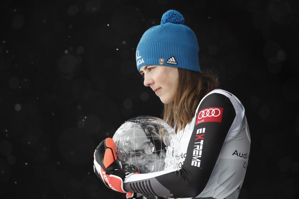 Slovakia's Petra Vlhova holds the trophy of the alpine ski, women's World Cup overall title, in Lenzerheide, Switzerland, Sunday, March 21, 2021. (AP ...