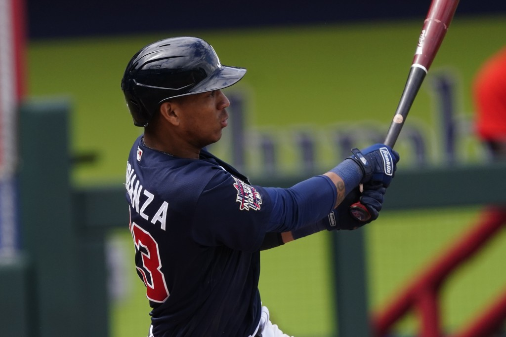 Atlanta Braves' Ehire Adrianza follows through on a two-run base hit in the fifth inning of a spring training baseball game against the Boston Red Sox...