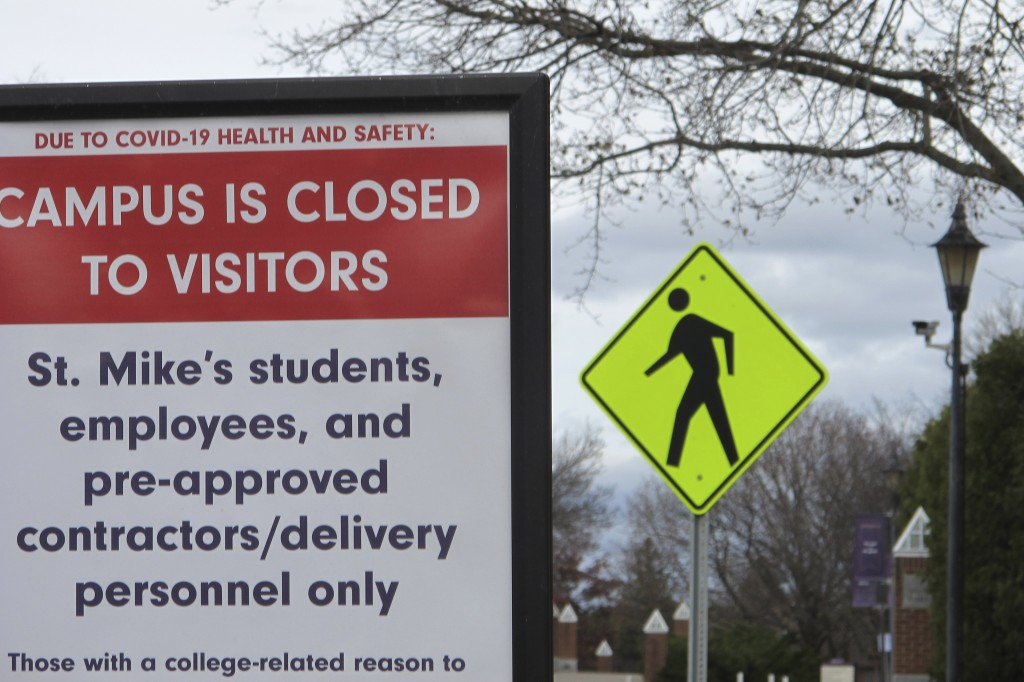 FILE - In this Nov. 12, 2020, file photo, a sign at the entranceway to St. Michael's College in Colchester, Vt., says that the campus is closed to vis...