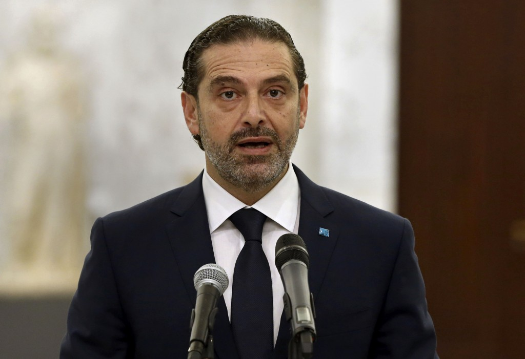 In this photo released by Lebanese government, Lebanese Prime Minister-Designate Saad Hariri, speaks to journalists after his meeting with Lebanese Pr...