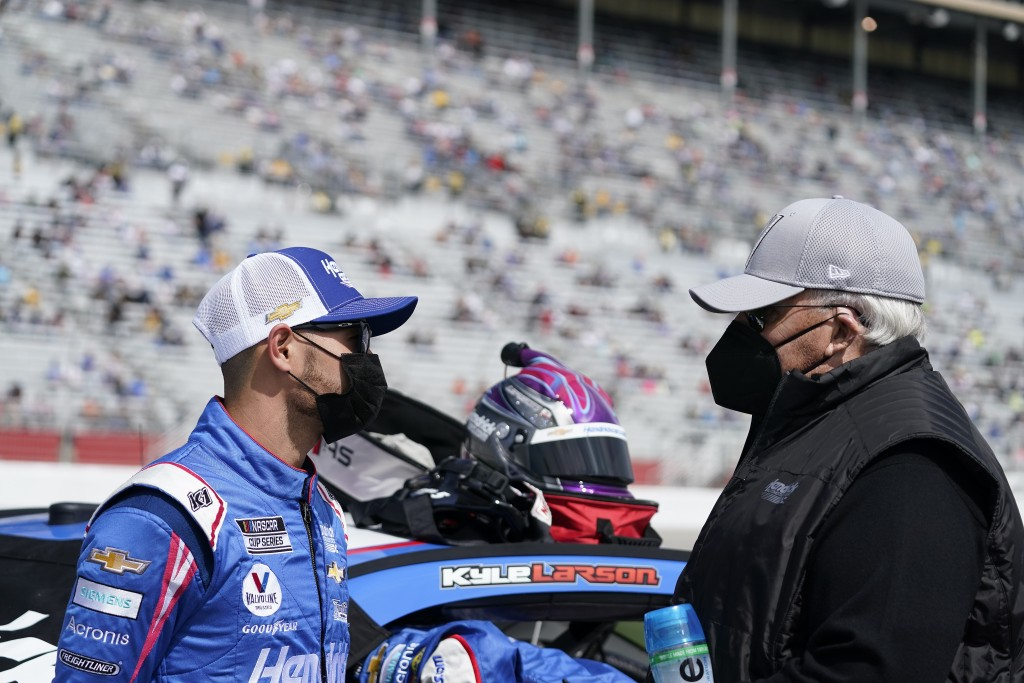 NASCAR Cup Series driver Kyle Larson, left, talks to the owner of the NASCAR team Hendrick Motorsports, Rick Hendrick, right, before a NASCAR Cup Seri...