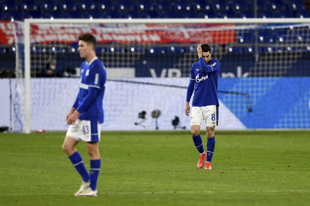 Schalke's Matthew Hoppe, left, and Suat Serdar react on the pitch during the German Bundesliga soccer match between FC Schalke 04 and Borussia Moenche...