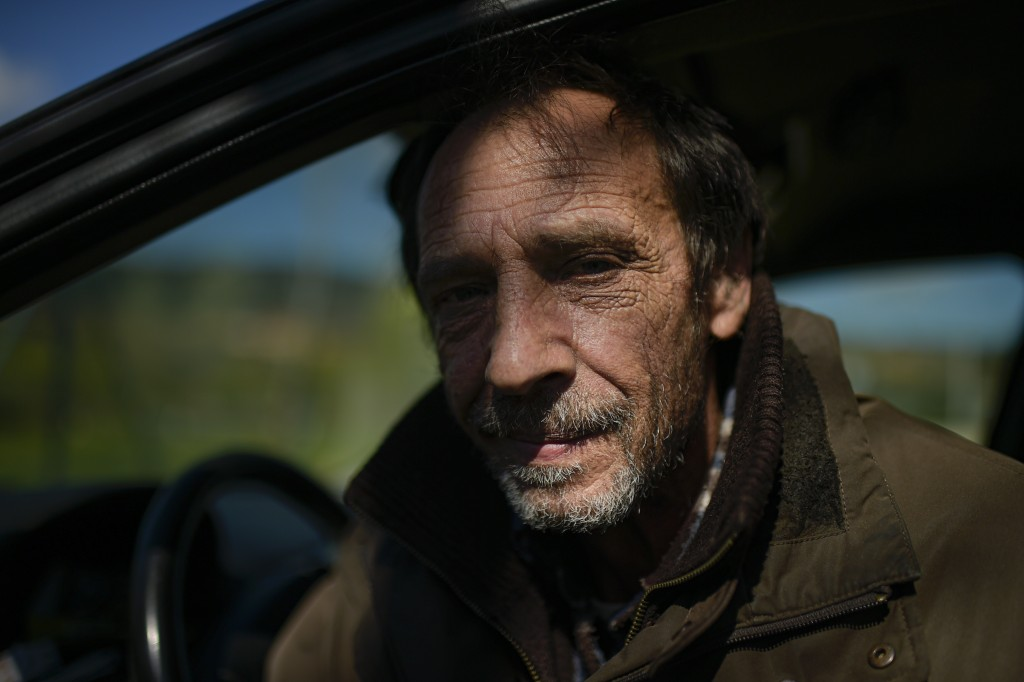 Juan Jimenez, 60, sits in his car which is now his home, in Pamplona, northern Spain, Wednesday, March 17, 2021. Jimenez has been forced to dwell in h...