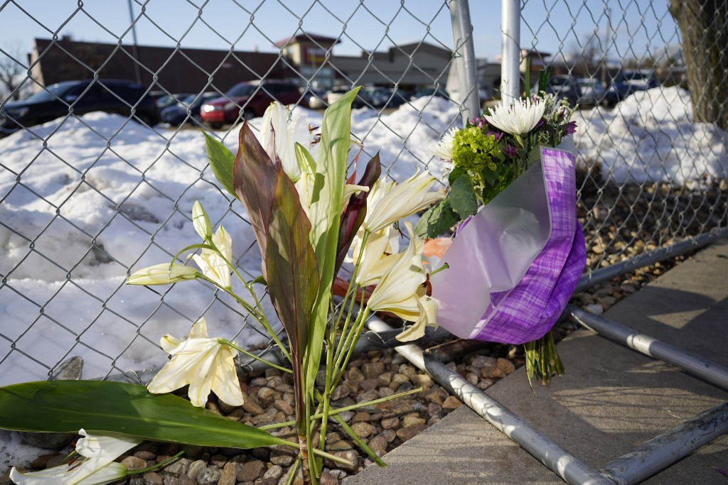 A small memorial stands along a makeshift fence put up around the parking lot outside a King Soopers grocery store where a mass shooting took place Tu...