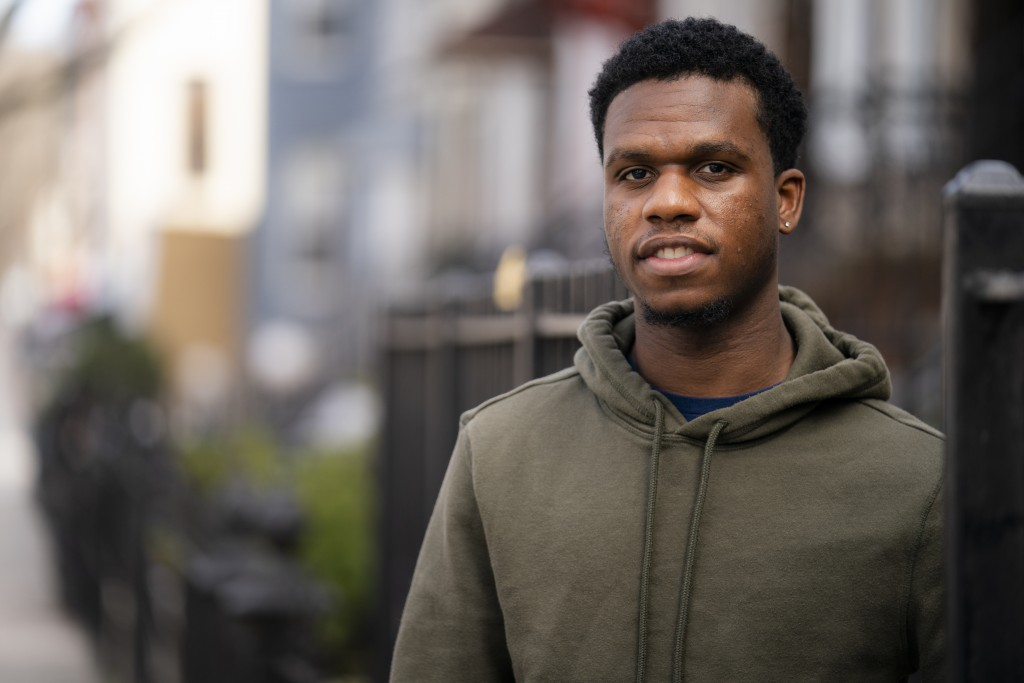 Mikel Haye poses for a portrait on his stoop, Friday, March 12, 2021, in the Brooklyn borough of New York.  Haye, who was forced into performing a fin...