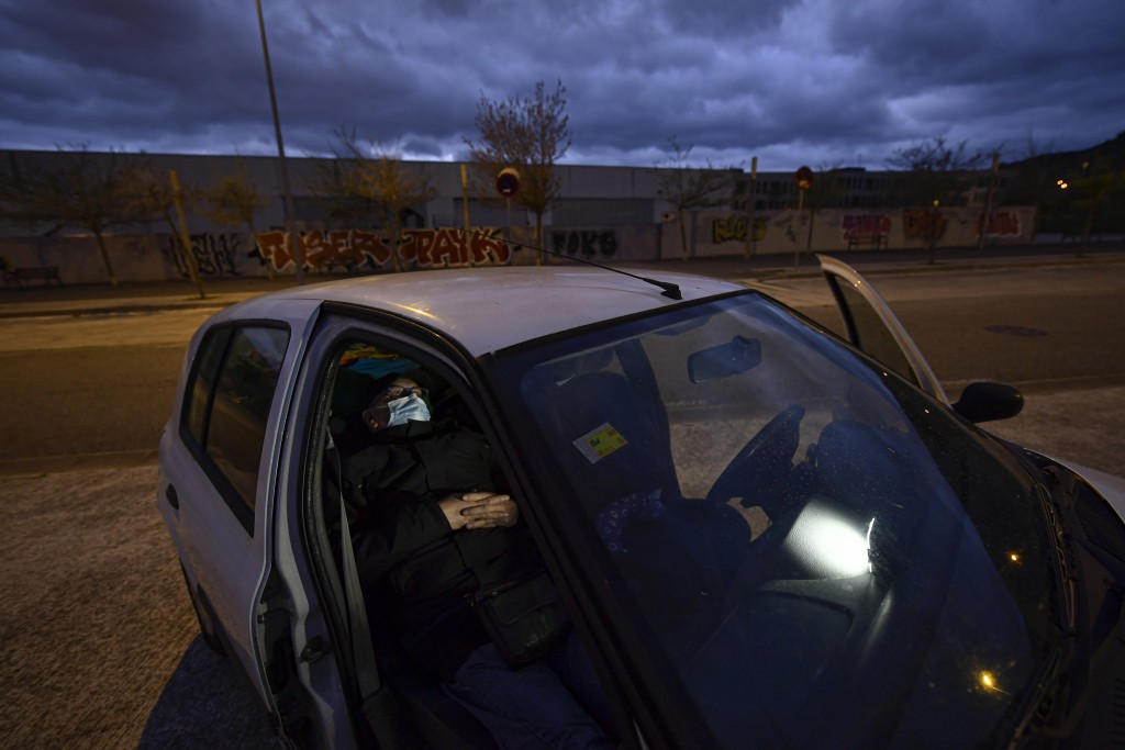 Javier Irure, 65 sits in his car which is now his home, in Pamplona, northern Spain, Thursday, March 18, 2021. Javier Irure had only one possible roof...