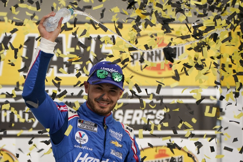 FILE - Kyle Larson celebrates after winning a NASCAR Cup Series auto race in Las Vegas, in this Sunday, March 7, 2021, file photo. Kyle Larson will re...