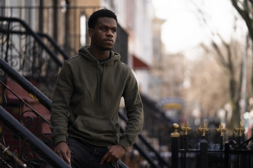 Mikel Haye poses for a portrait on his stoop, Friday, March 12, 2021, in the Brooklyn borough of New York.   Haye, who was forced into performing a fi...