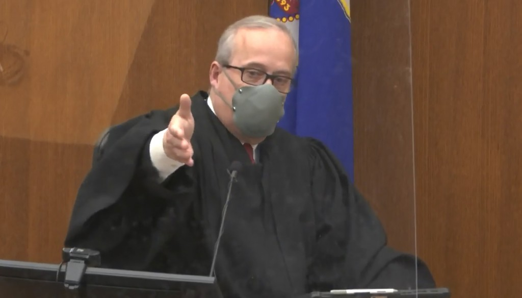 In this screen grab from video, Hennepin County Judge PeterCahill presides over jury selection, Tuesday, March 23, 2021, in the trial of former Minne...