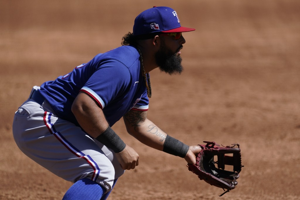 Texas Rangers second baseman Rougned Odor (12) stands at the ready during the third inning of a spring training baseball game against the Colorado Roc...
