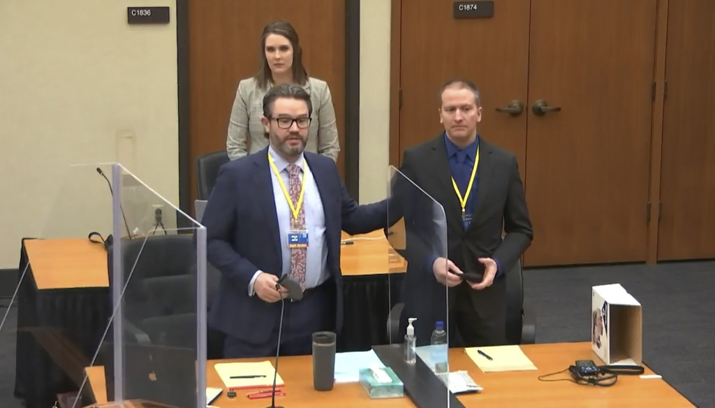 In this screen grab from video, defense attorney Eric Nelson, left, defendant and former Minneapolis police officer Derek Chauvin, right, and Nelson's...