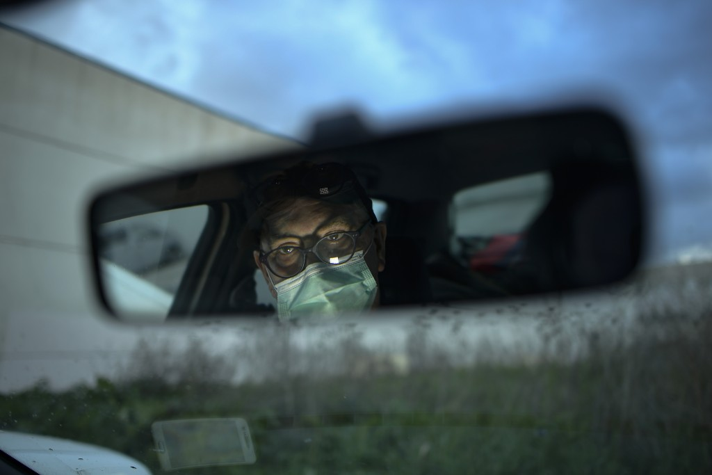 Javier Irure, 65, is pictured through the rear view mirror of his car which is now his home, in Pamplona, northern Spain, Friday, March 19, 2021. Javi...
