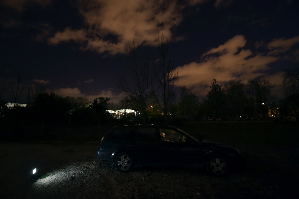 Juan Jimenez, 60, sits in his car which is now his home, in Pamplona, northern Spain, Tuesday, March 17, 2021. Jimenez moves his car from one quiet pa...
