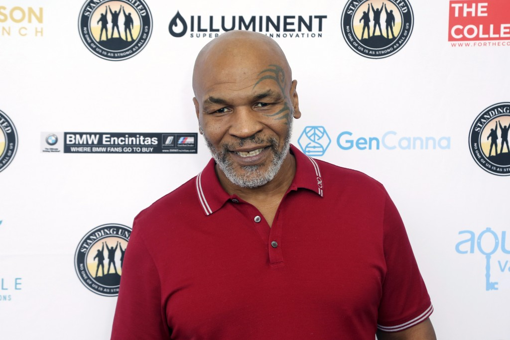 FILE - Mike Tyson attends a celebrity golf tournament on Aug. 2, 2019, in Dana Point, Calif. Tyson says he's producing a limited series about his life...