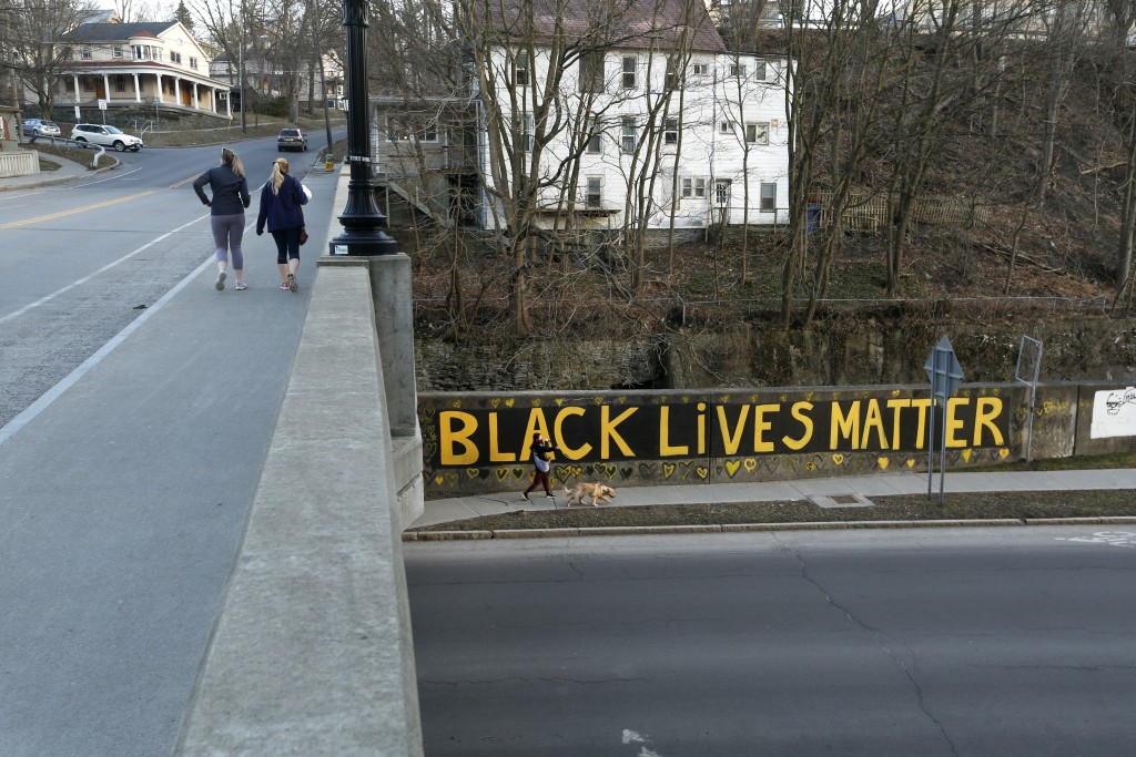 Black Lives Matter is seen along East Green Street where is passes under South Aurora Street, Monday, March 22, 2021, in Ithaca, N.Y.    The nationwid...