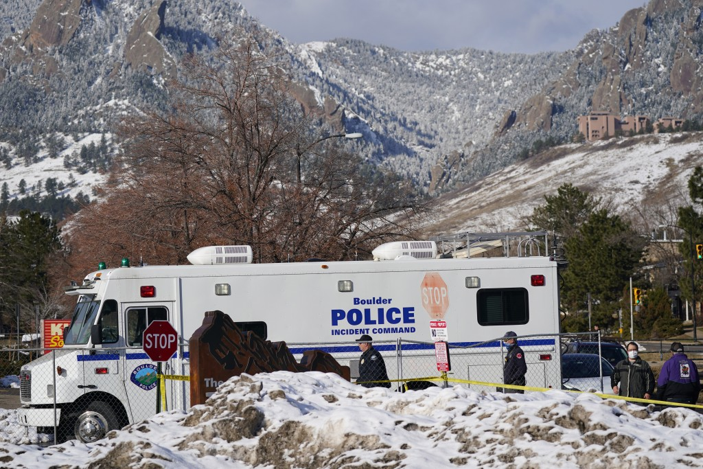 Police head into the parking lot outside a King Soopers grocery store where a mass shooting took place Tuesday, March 23, 2021, in Boulder, Colo. (AP ...