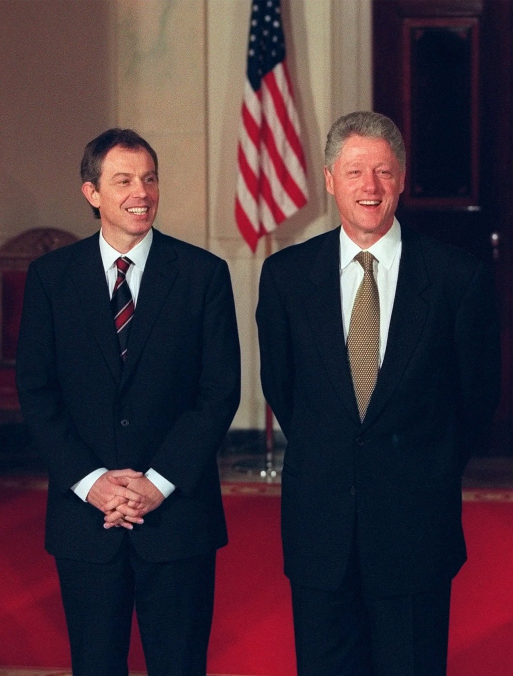 FILE - In this Feb. 5, 1998, file photo President Bill Clinton, right, and British Prime Minister Tony Blair stand during a welcoming ceremony for Bla...