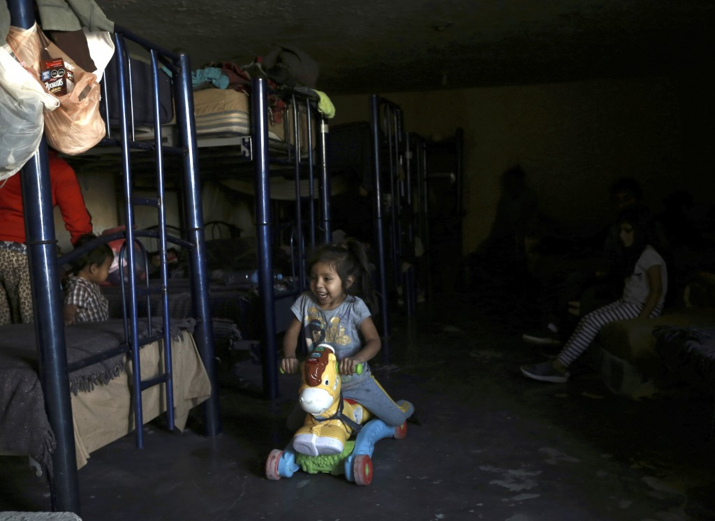 A migrant toddler plays on a ride on toy at a shelter in Ciudad Juarez, Mexico, Tuesday, March 23, 2021. Mexico announced that U.S. advisers on border...