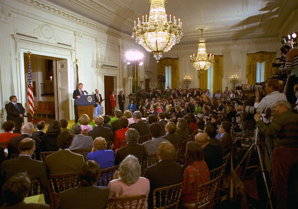FILE - In this March 23, 1993, file photo, members of the media fill the East Room of the White House during President Bill Clinton's first formal new...