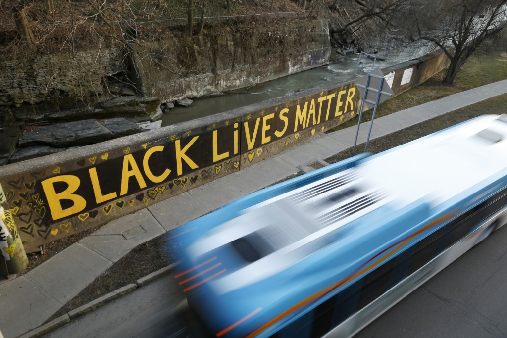 Black Lives Matter is seen along East Green Street, Monday, March 22, 2021, in Ithaca, N.Y.  The nationwide reexamination of policing after the killin...