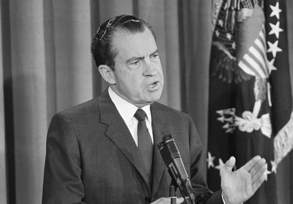FILE - In this Jan. 27, 1963, file photo President Richard Nixon speaks during first news conference as president in the East Room of the White House ...