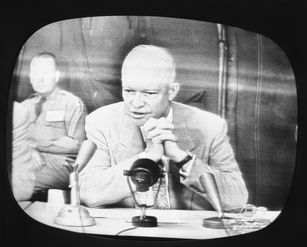 FILE - In this June 15, 1955, file photo, President Dwight D. Eisenhower, shown on an NBC Television monitor television receiver in New York reports t...