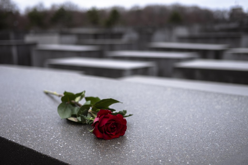 FILE - In this Jan.27, 2019 file photo a red rose lies on a slab of the Holocaust Memorial to commemorate the victims of the Nazis in Berlin. Germany ...