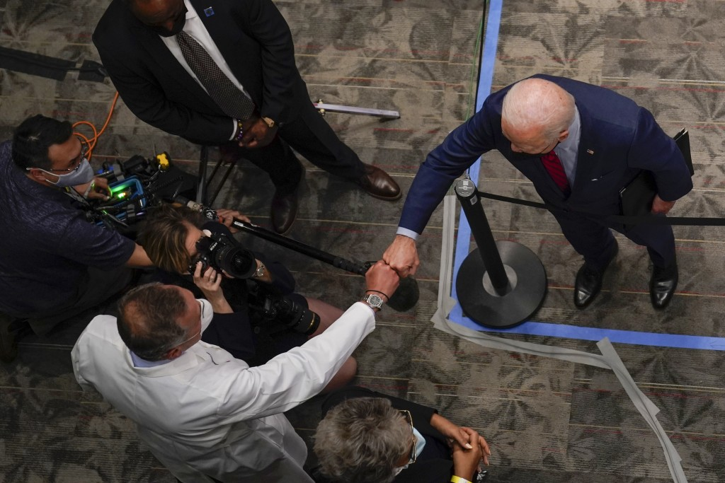 President Joe Biden fist bumps a doctor at the James Cancer Hospital and Solove Research Institute at The Ohio State University, Tuesday, March 23, 20...