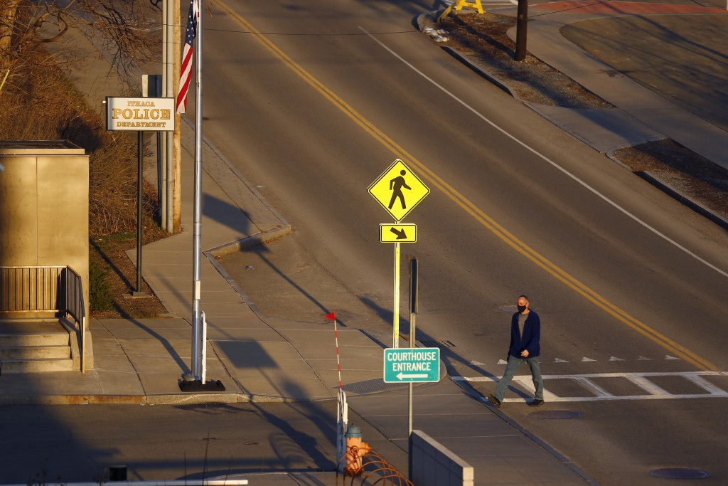 A pedestrian walks by the Ithaca Police Department headquarters on Monday, March 22, 2021, in Ithaca, N.Y.   The nationwide reexamination of policing ...