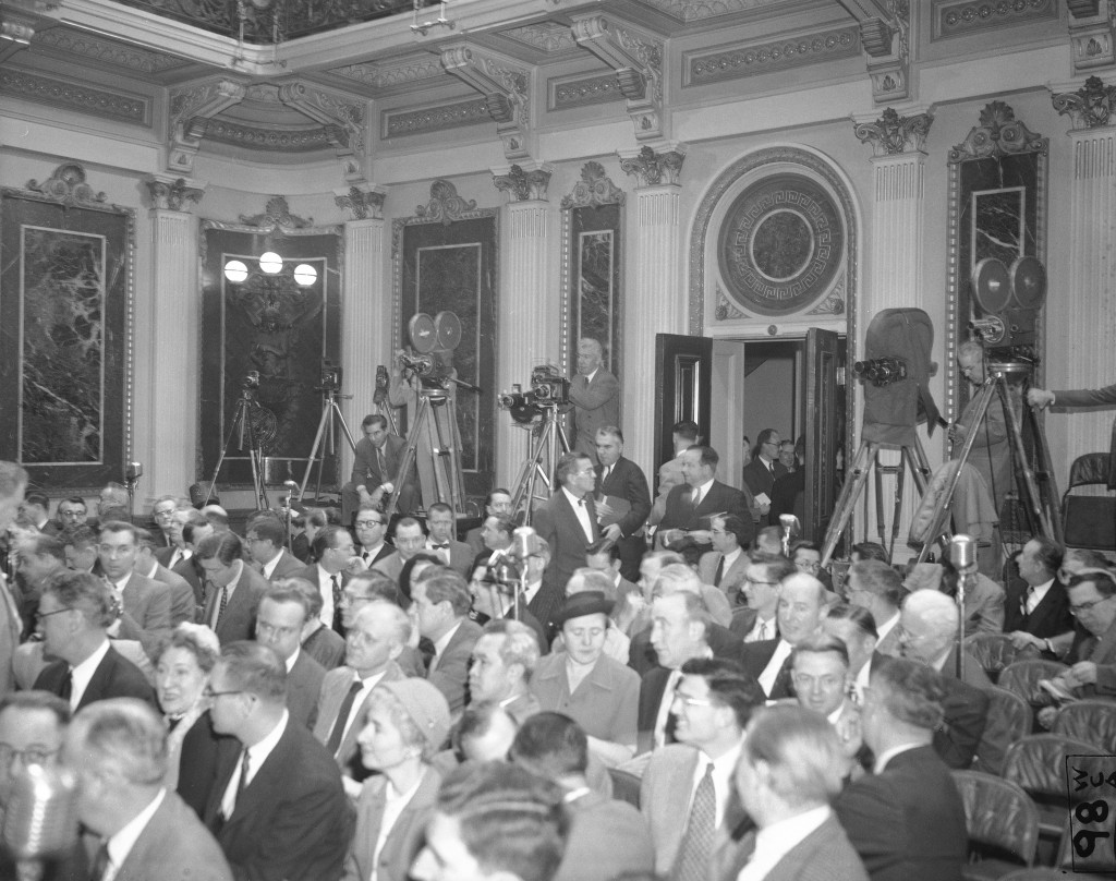 FILE - In this Jan. 19, 1955, file photo photographers have their equipment set up at the back of the room as reporters take their places for Presiden...