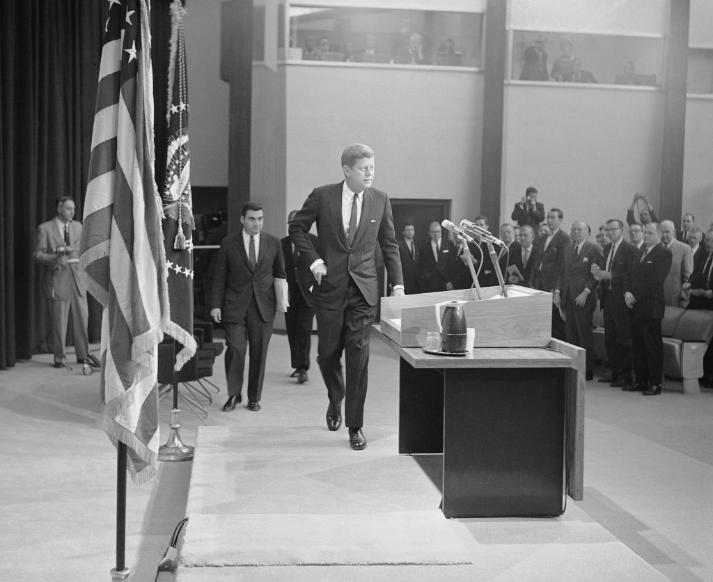 FILE - In this Jan. 25, 1961, file photo President John Kennedy walks toward the rostrum in the auditorium of the new State Department building in Was...