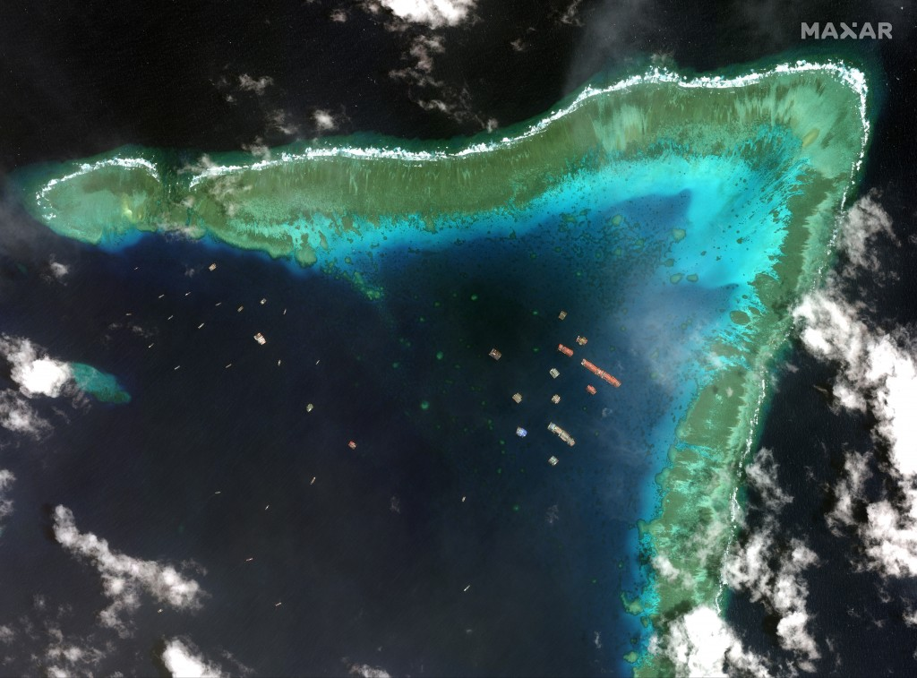 This satellite image provided by Maxar Technologies shows Chinese vessels in the Whitsun Reef located in the disputed South China Sea. Tuesday, March ...