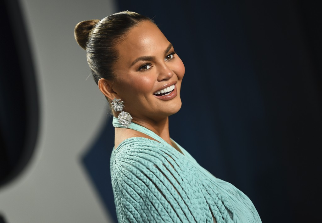 FILE - In this Feb. 9, 2020, file photo, Chrissy Teigen arrives at the Vanity Fair Oscar Party in Beverly Hills, Calif. Teigen has deleted her popular...