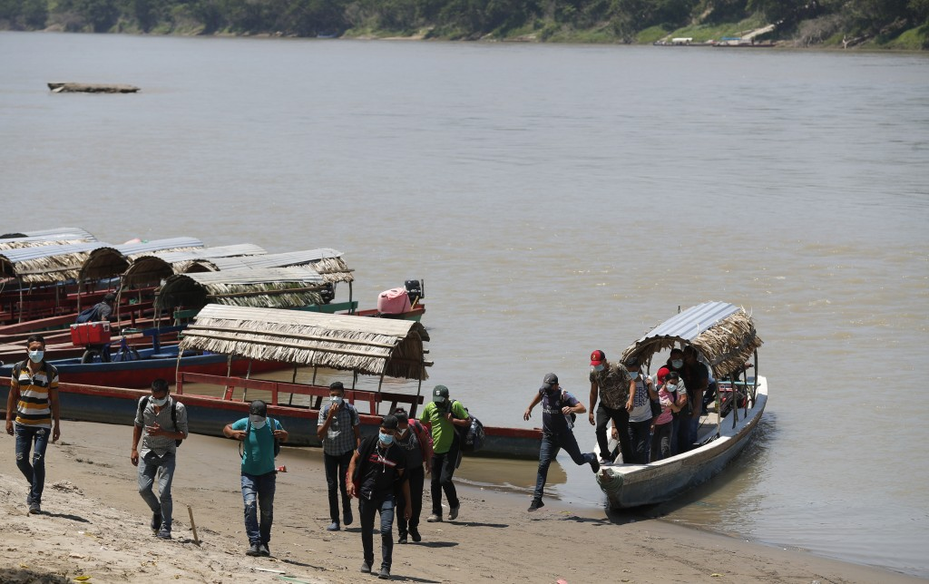 Migrants disembark on the Mexican side of the border after crossing the Usumacinta River from Guatemala, in Frontera Corozal, Chiapas state, Mexico, W...