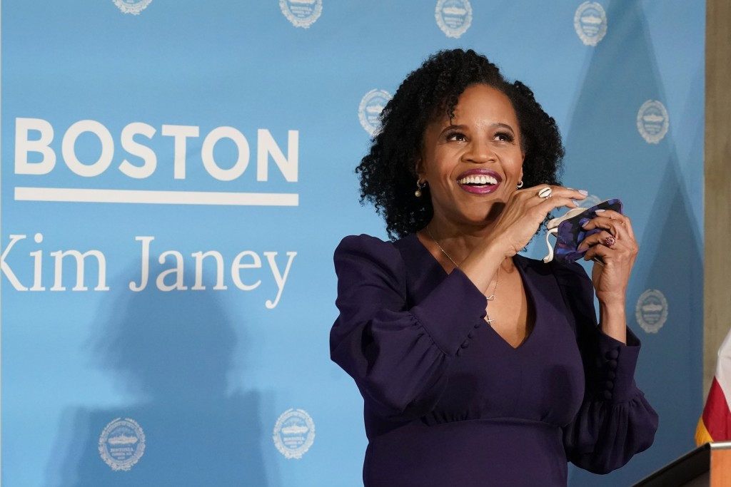 Former Boston City Council President Kim Janey, 55, takes off her face mask to speak after she was sworn in as Boston's new mayor at City Hall, Wednes...