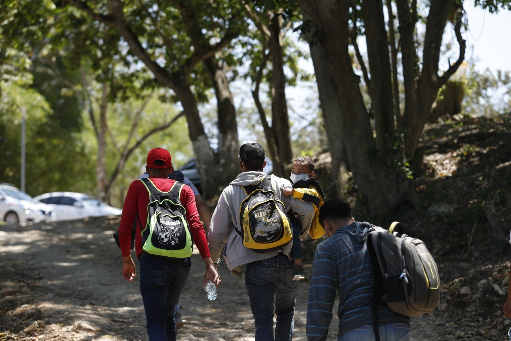 Migrants walk into Mexico after crossing the Usumacinta River from Guatemala, in Frontera Corozal, Chiapas state, Mexico, Wednesday, March 24, 2021. (...