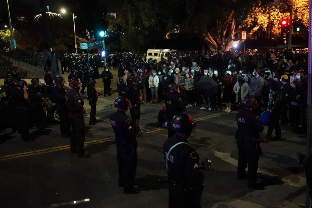 Demonstrators face off with police during a protest in the Echo Park section of Los Angeles Thursday, March 25, 2021. Demonstrators gathered Wednesday...