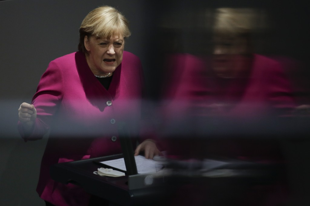 German Chancellor Angela Merkel addresses the German parliament Bundestag ahead of an European Union summit at the Reichstag building in Berlin, Germa...