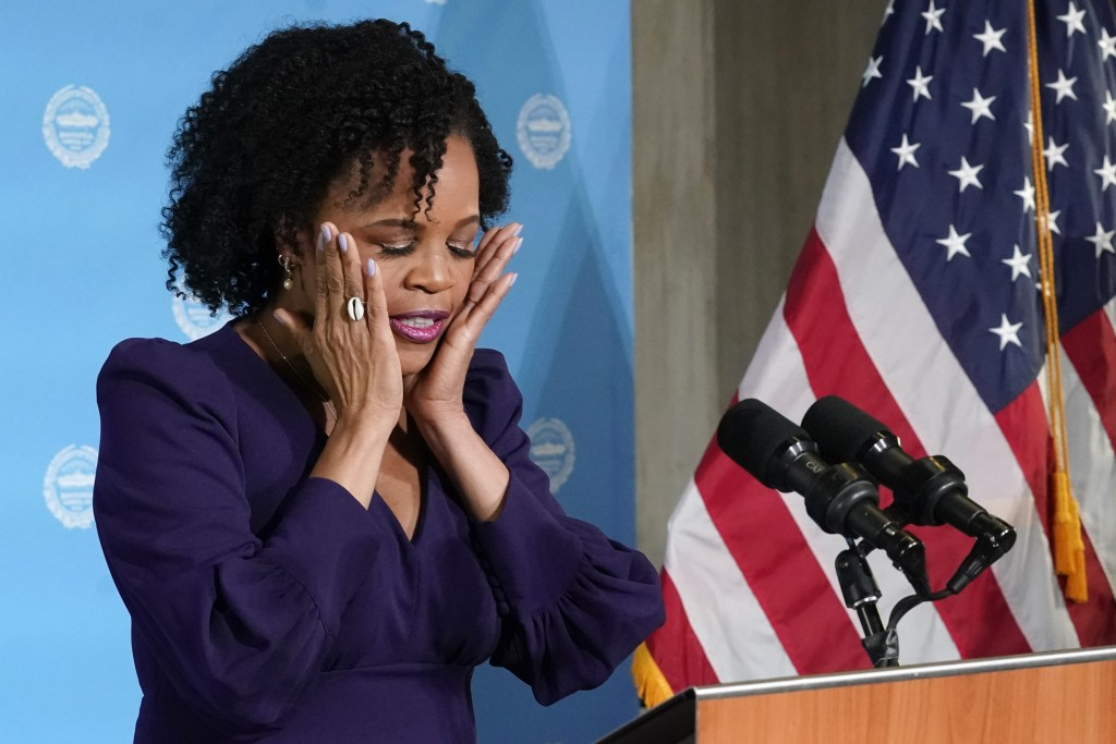 Former Boston City Council President Kim Janey, 55, composes herself as she begins to speak after being sworn in as Boston's new mayor at City Hall, W...