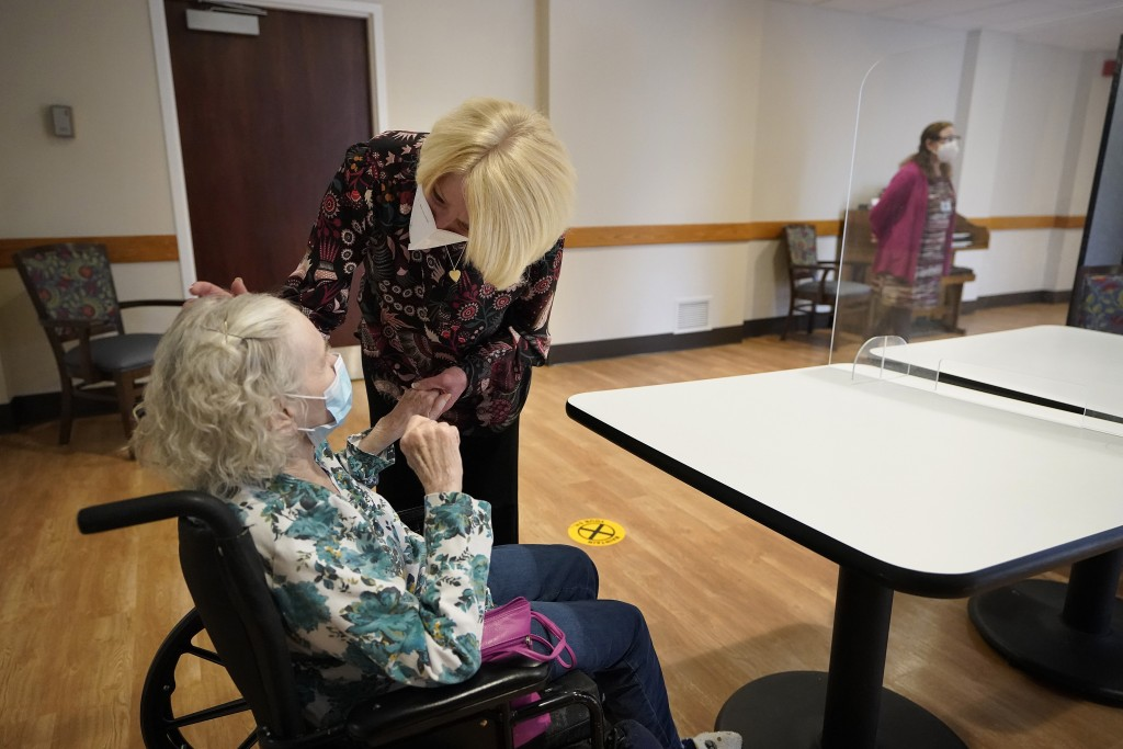 FILE - In this March 18, 2021, file photo, Mary Claire Lane, 86, left, a resident at Hellenic Nursing and Rehabilitation Center, in Canton, Mass., is ...