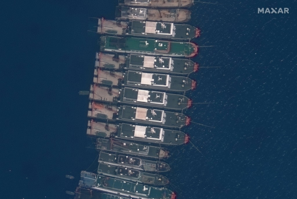This satellite image provided by Maxar Technologies shows Chinese vessels anchored the Whitsun Reef located in the disputed South China Sea. Tuesday, ...