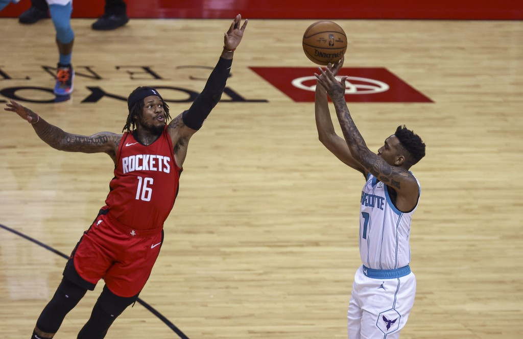 Charlotte Hornets guard Malik Monk (1) shoots as Houston Rockets guard Ben McLemore (16) defends during the second quarter of an NBA basketball game W...